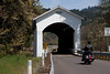 Motorcyclists enjoy a ride through the Mosby Creek covered bridge in Lane County in central Oregon.<br /> Photo © Carl Clark