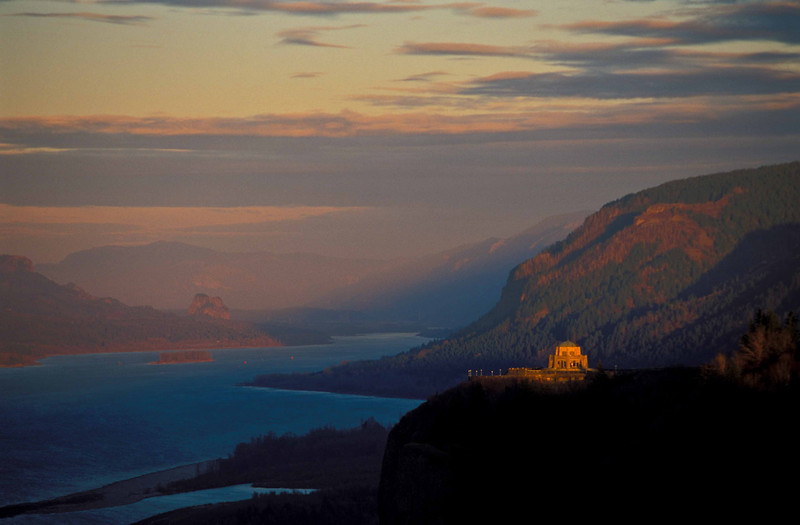 Vista House, built in 1916, catches the last light at Crown Point, on the Oregon side of the Columbia River Gorge.<br /> Photo © Carl Clark