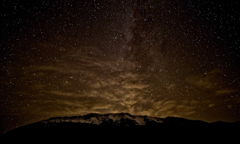Clouds transition to Milky Way over the Wallowas, Oregon.<br /> Photo © Cindy Clark