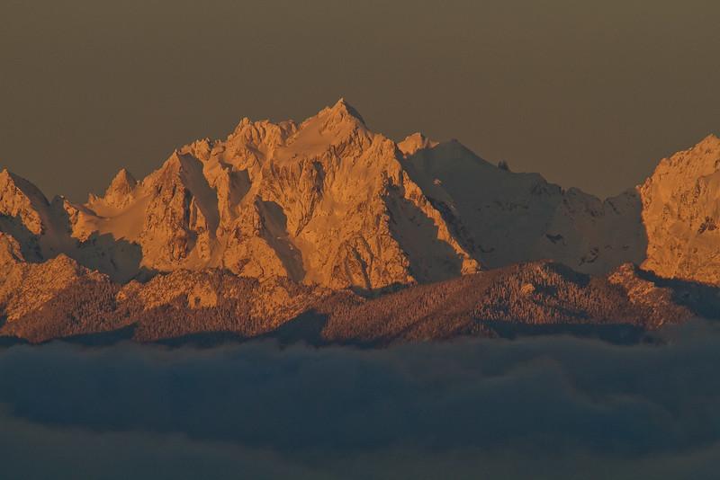 Winter snow blankets Mt Constance over a sea of fog - Washington Olympic Mts.<br /> Photo © Carl Clark