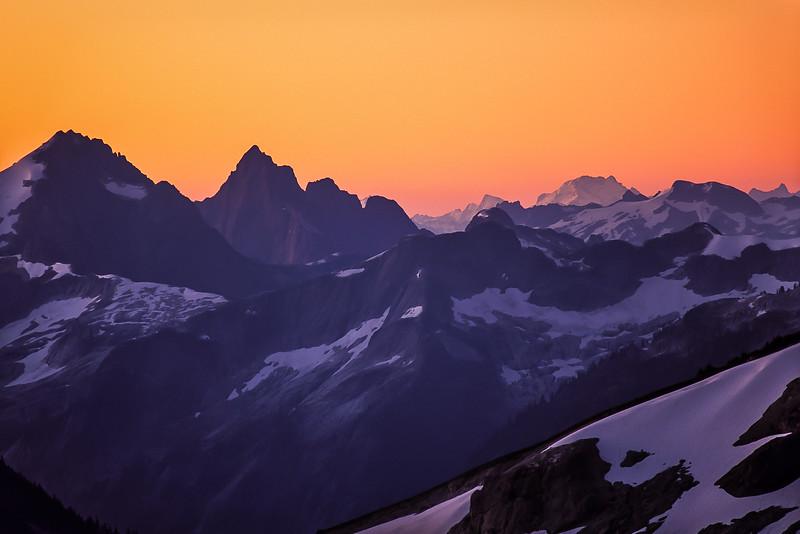 The spire of Mt Triumph greets the dawn - Washington Cascades.<br /> Photo © Carl Clark