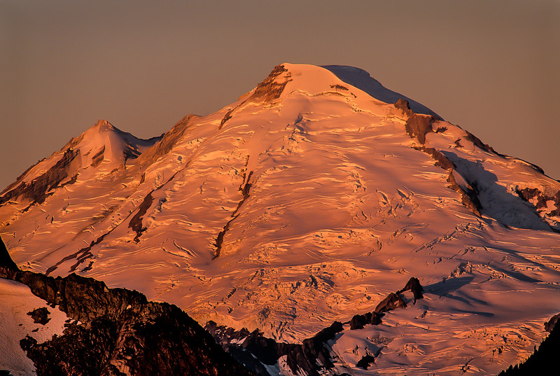 Mt Baker glaciers bathed in early morning light - Washington Cascades.<br /> Photo © Carl Clark
