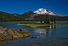 Kayakers exploring Sparks Lake west of Bend, Oregon with the South Sister in the background.<br /> Photo © Carl Clark