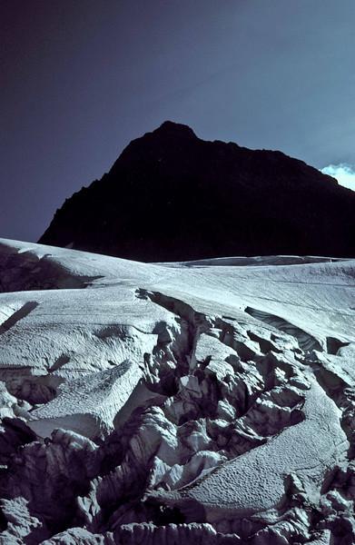 Upper Curtis Glaicier curves to the summit of Mt Shuksan - Washington Cascades.<br /> Photo © Carl Clark