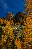 The warm rock of Liberty Bell surrounded by autumn larches, North Cascades, Washington.<br /> Photo © Carl Clark