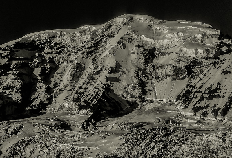 The north side of Mt. Rainier divided by Liberty Ridge.<br /> Photo © Carl Clark