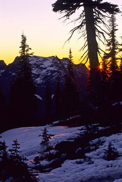 The sun sets behind Big Four Mt  - Washington Cascades.<br /> Photo © Carl Clark