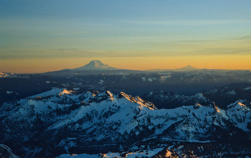 Mt Adams and Mt Hood in the distance from Camp Muir on Mt Rainier.<br /> Photo © Carl Clark