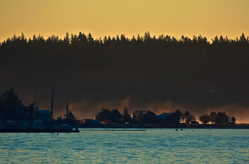 An early morning ferry ride from Anacortes rewards passengers with views such as this.<br /> Photo © Cindy Clark