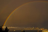 Rainbows light up a stormy day in Seattle.<br /> Photo © Carl Clark