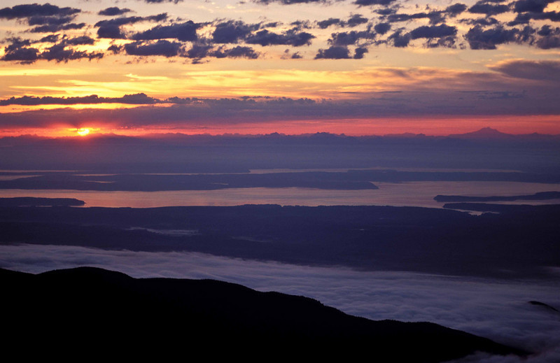 Sunrise over fog-filled Hood Canal and Puget Sound from the summit of Mt Townsend.<br /> Photo © Carl Clark