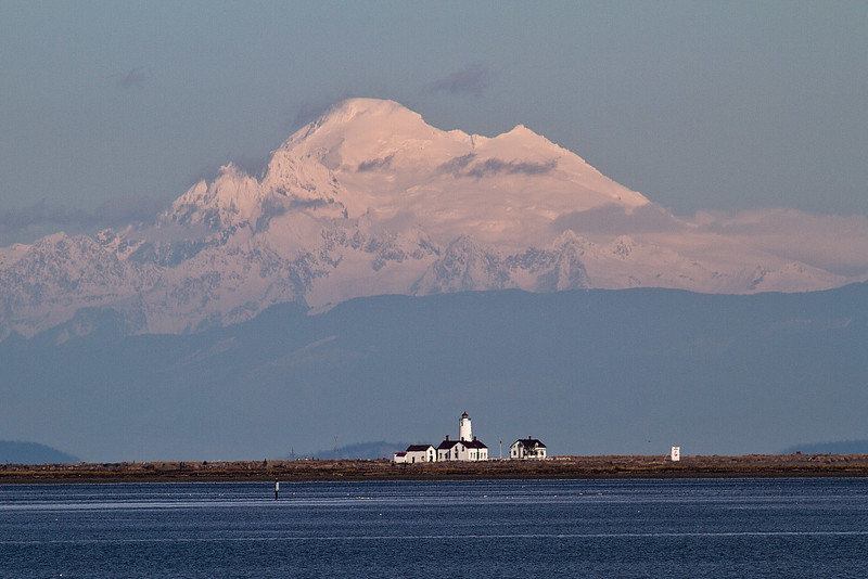 Snowy Mt Baker dominates the sky over Dungeness Lighthouse.<br /> Photo © Carl Clark