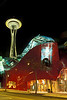 Old and the new:  The Space Needle rightly towers over Experience Music Project in Seattle.<br /> Photo © Carl Clark