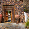 Large Jugs Old Doors and Stone at the Karokia Inn in Palm Springs California