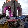 Tents set up in protest next to one of Mexico City's several impressive monuments.