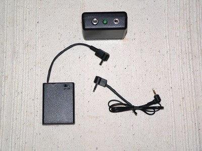 Power supply, remote control, and camera cable