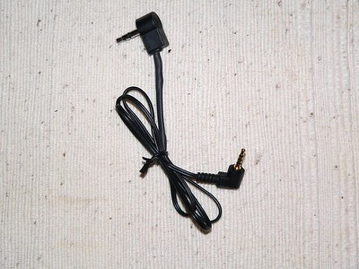 Cable to camera -- 4 conductor plug on camera end, stereo plug on remote control end
