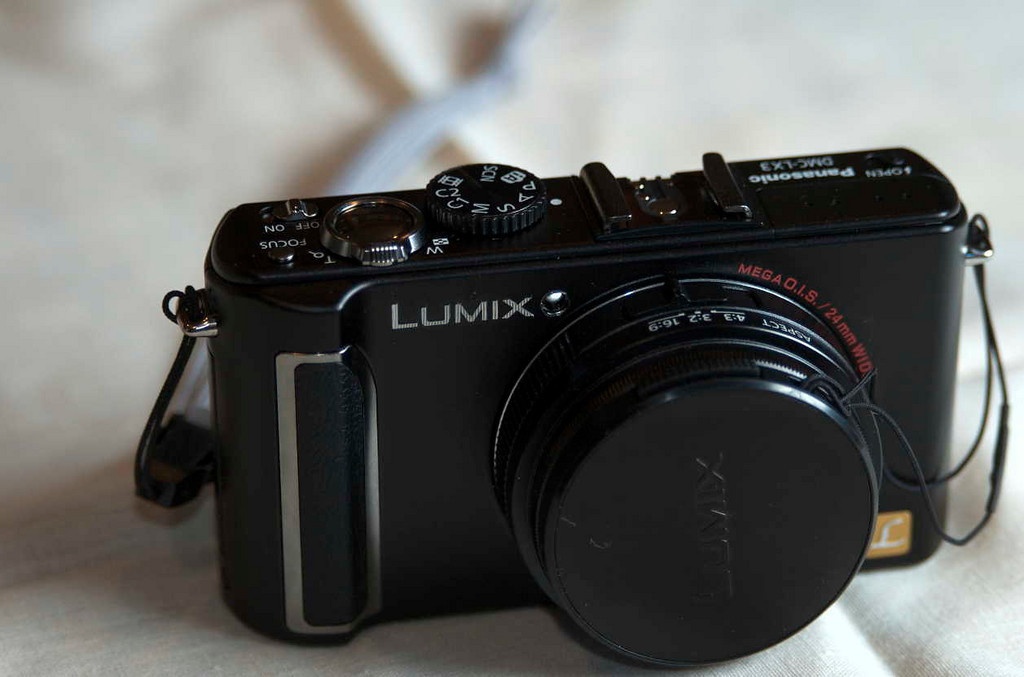 "The Pentax Lumix LX3. Photos of the LX3 were taken with a Nikon D70 with its built-in flash in ""commander mode,"" and a Speedlight SB-600 shooting through a white umbrella."