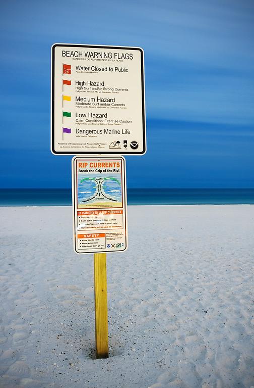 Beach Flag warning sign on Pensacola Beach.