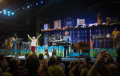Jimmy Buffett closed his Pensacola show singing in front of a 25 foot tall photo of mine. An exclamation point on a great night.