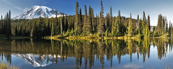 The sun setting on Mount Rainier and one of the smaller reflection lakes near Paradise in Mount Rainier National Park.  2 image Panorama.            This image is best printed in a 1x2.5 aspect ratio.