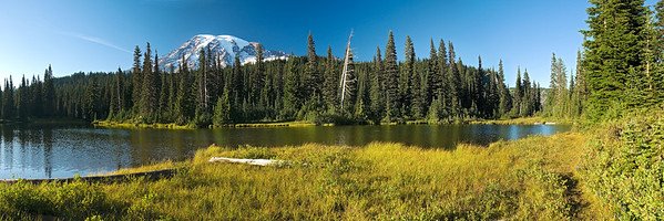 Mount Rainier National Park, September 11, 2009.  Three shot panorama of Mt Rainier and one of the smaller reflection lakes.                  This image is best printer in a 1x3 aspect ratio.
