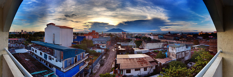 The view from the roof of The Pacific Breeze in Angeles City, Philippines.  Mt. Arayat is in the background.