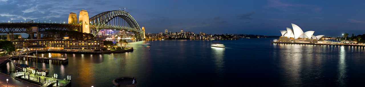 A panorama of the Sydney Harbor, the Sydney Harbor Bridge and the Opera House.