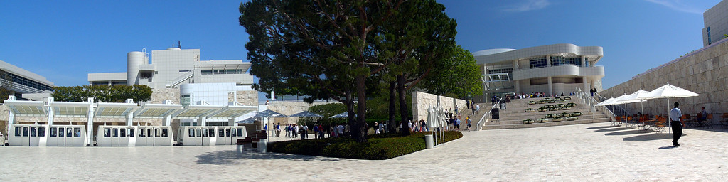 A three car tram takes visitors from the parking garage to the Arrival Plaza. Panorama combining 6 shots