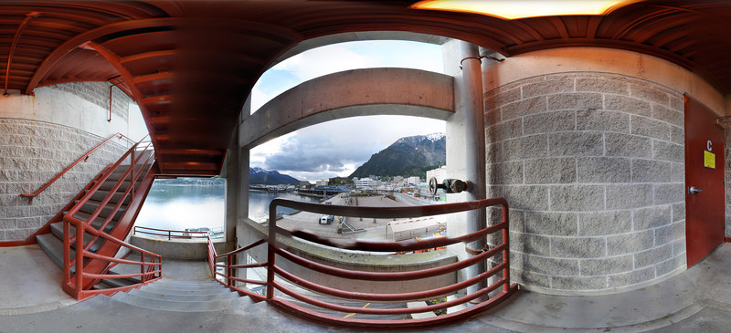 Panorama with Stitching Errors noticeably on the railing in the foreground & on the underside of the descending staircase.  Taken from inside a stairwell at the Juneau Public Library, downtown Juneau Alaska.  Shot with a Nikon d700 on a Nodal Ninja Head, edited in PT GUI & Photoshop CS 5.