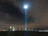 This photo was taken from Jersey City, New Jersey of the Tribute in Light.<br /> That blur on the right is a boat.