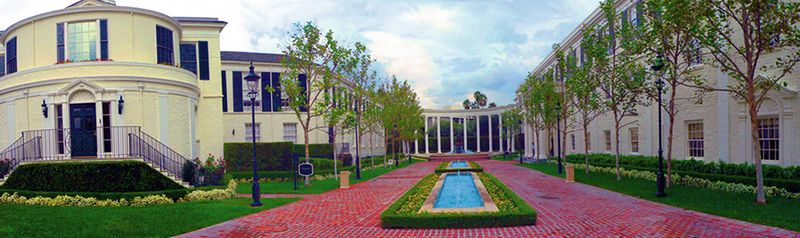 A beautifully designed office space by Paul Revere Williams, the first African American architect in Los Angeles. When his practice took off in the 1920s, blacks could not live in Hancock Park or Holmby Hills, but he designed mansions there and by 1940 was known as the architect to the stars. At the time, discrimination was so pervasive that he learned to read and draw upside down because he knew that white clients would not sit next to him.  Williams' respected designs include the former Perino's restaurant on Wilshire, the original Saks Fifth Avenue in Beverly Hills and (below) what used to be the MCA headquarters (later Litton Industries, then Global Crossing, now Paradigm Agency) on Burton Way in BH.