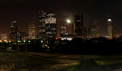 Houston, Texas Skyline at night on July 6, 2009 with the full moon rise over downtown