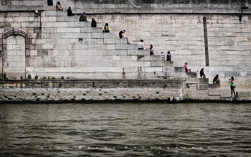 A well used riverside wall on the Seine River, Paris