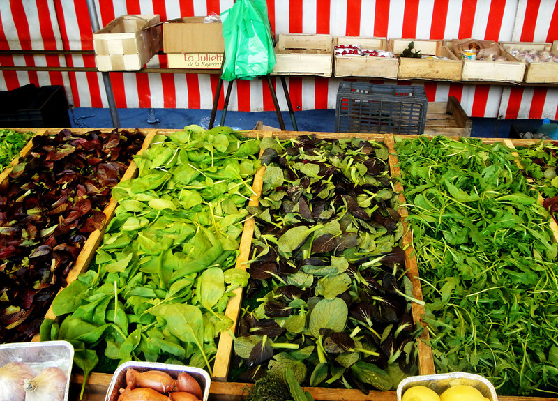 Shopping for a salad in a street market in Paris France