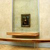 The famous Mona Lisa Painting by Leonardo da Vinci hanging in the Louvre in Paris France