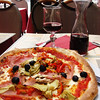 Pizza with wine in Paris