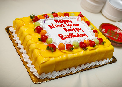 Today is not just Lunar New Year, but also Kristina's birthday.   That's not orange icing on her celebratory cake, but actual sliced mangoes draped over sponge cake, layered with whipped cream.