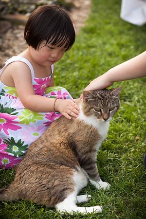 Ella pets Moe ever so gently