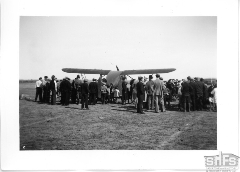 [Crowd watches an airplane show, Gravelbourg]