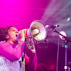 Natalie Natiembe at Womad 2011. This show had a photography pit so it was easier to move around. When I saw that lighting I scuttled around to line up the Megaphone with the lighting giving the illusion of light/sound eninating