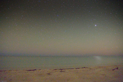 Ocean in Jupiter shine. Ocean in not sun, not moon, but jupiter shine. Taken in 30s. Taken on a tropical beach with a mini tripod. Using a K-x, ISO 3200 and heavy pushing levels in post processing.