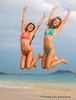 Twin sisters leaping for joy on Lanikai Beach