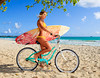 beautiful Sara on her bicycle with her surfboard at kailua beach, hawaii