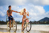 newlywed couple on the beach with their bicycles