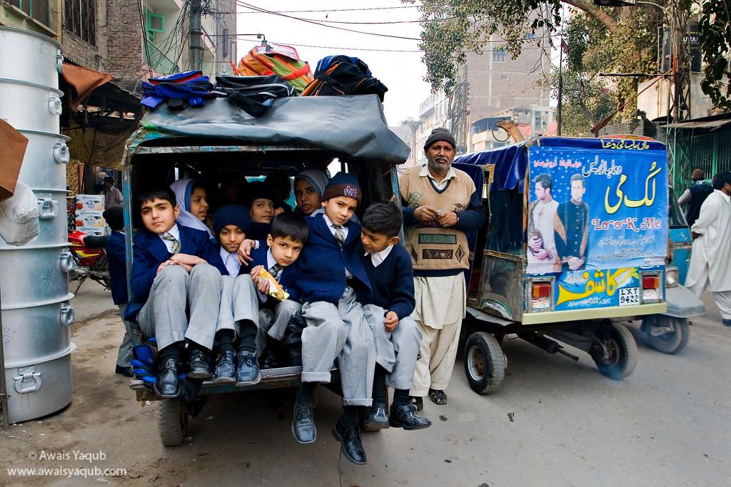 School kids all packed in Rikshaw after school