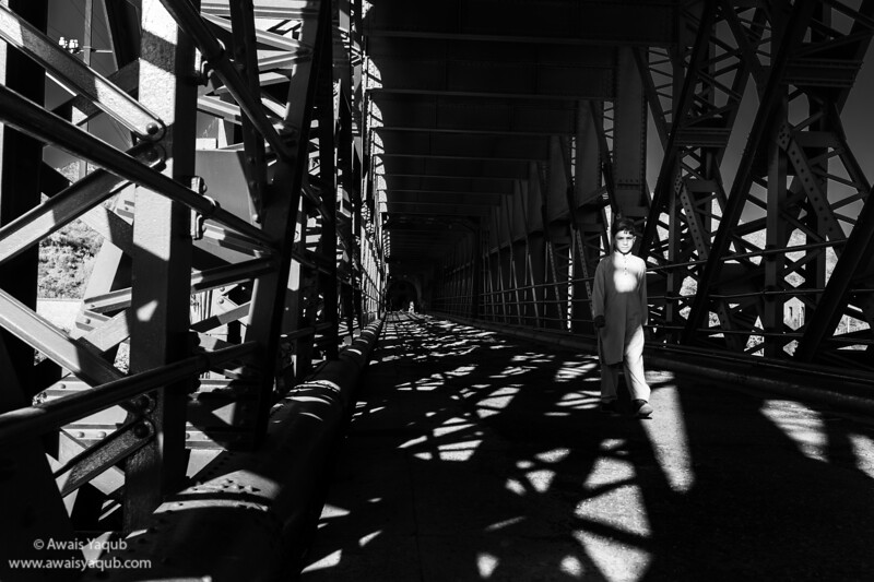 Boy walks through Attock Khurd railway bridge. Bridge was built during british rule in subcontinent and still operational.