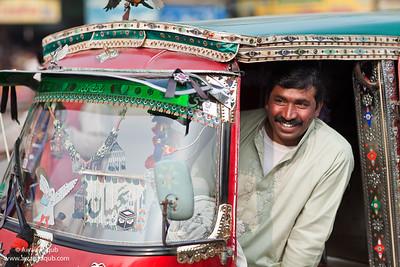 Rikshaw driver in streets of Multan Pakistan