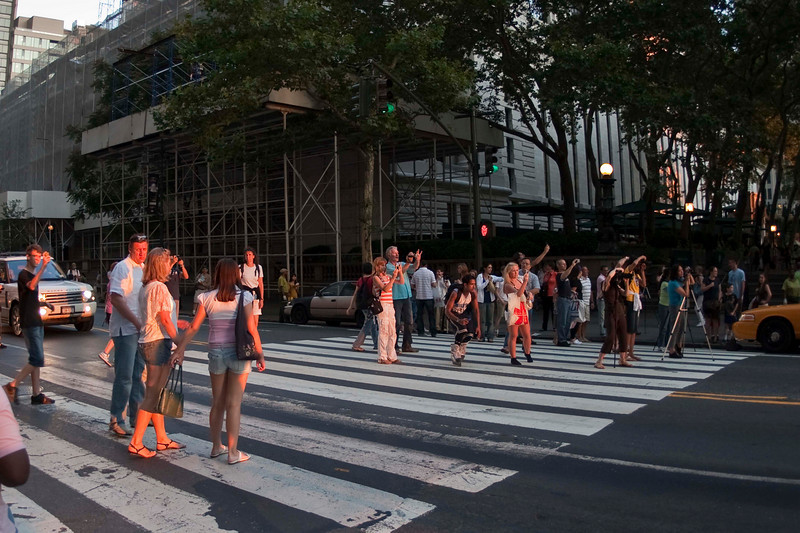 """Shooting """"Manhattanhenge""""  (Twice a year, a few weeks before and after the Summer Solstice, the setting sun aligns perfectly with the street grid of Manhattan, which is skewed about 30 degrees off a traditional north/south/east/west grid)."""