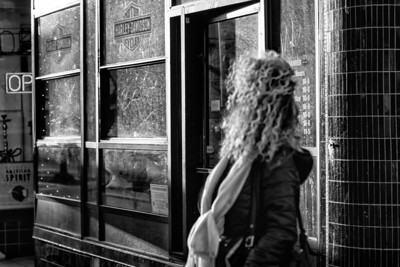 This woman with long curly hair walked into my frame unexpectedly.